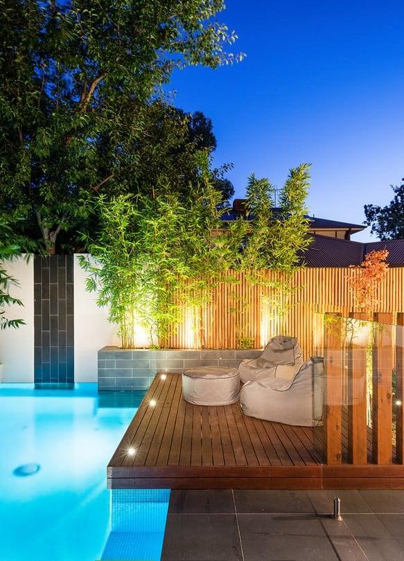 summer autumn transition lit pool