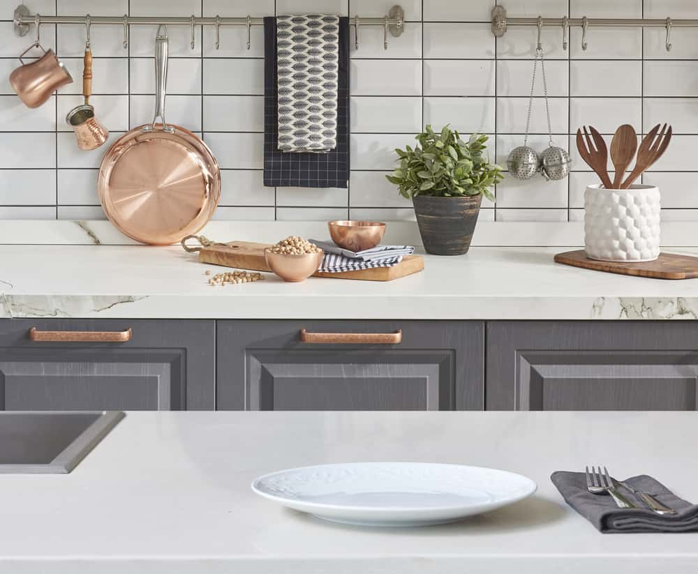 marble and grey kitchen cabinets with rose gold hardware