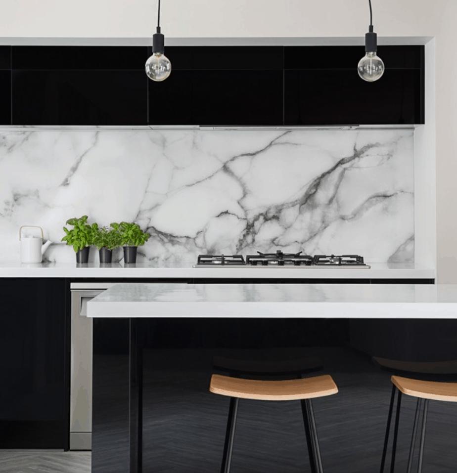black kitchen with stunning white marble splashback